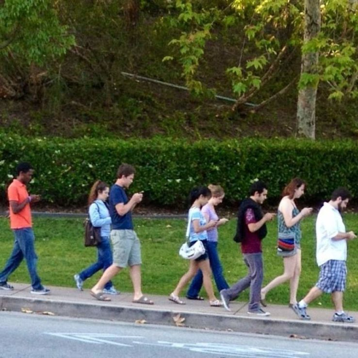 people walking with cell phones
