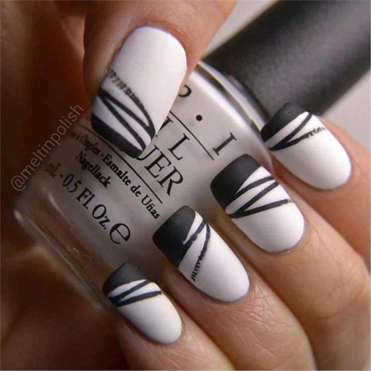 white nails black design
